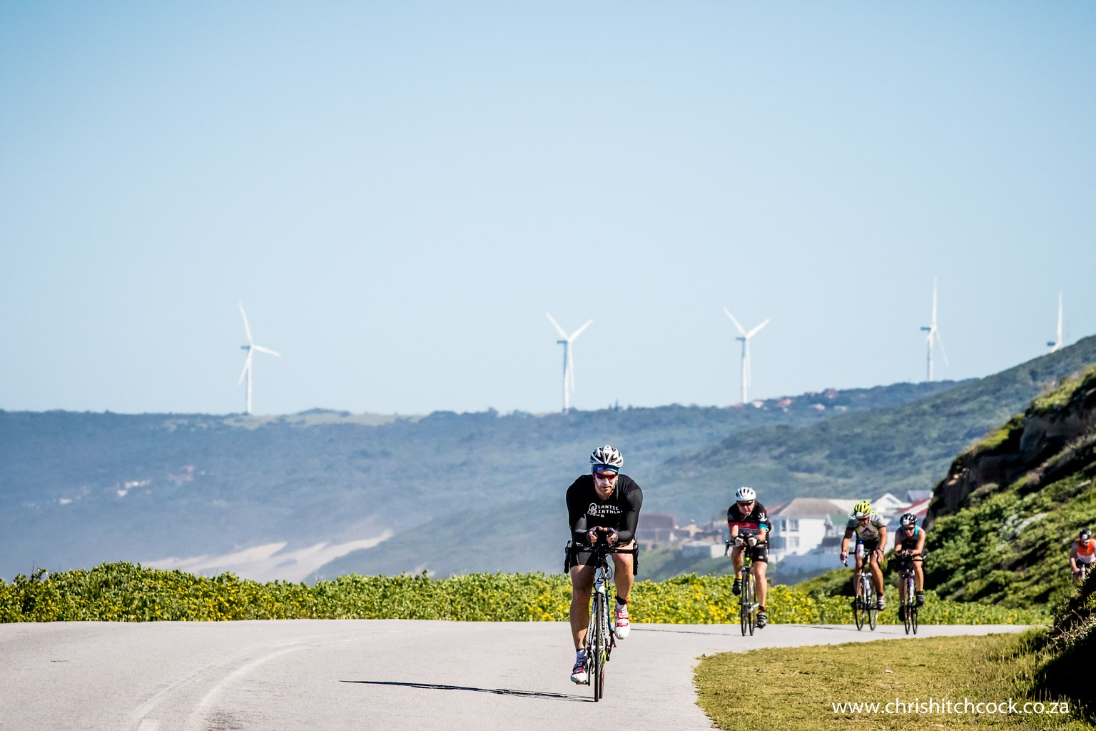 The wind generators in the background are there because there are always winds along this coast. This is where riders start to feel the first bit of hurt on lap one of the cycle. The smiles will be completely gone by lap two.